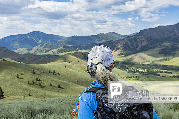 Rear view of mature woman hiking in Sun Valley  Idaho  USA