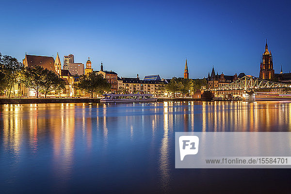 Buildings by river at sunset in Frankfurt  Germany