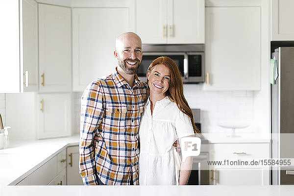 Smiling couple in kitchen