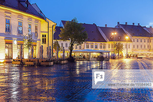 Wet Grand Square at sunset in Sibiu  Romania