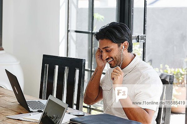 Businessman talking on cellular phone in office
