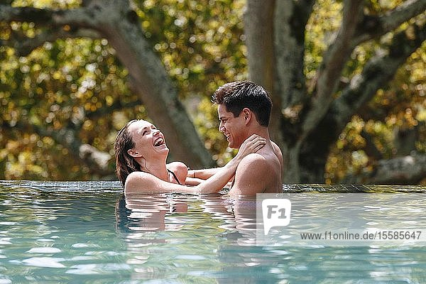 Couple laughing in swimming pool