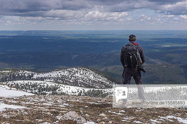 Hiker on top of mountain range  Calgary  Canada