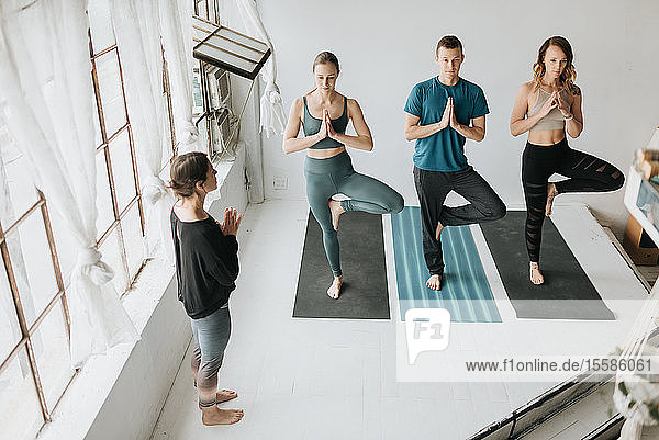 Yoga instructor teaching yoga in studio
