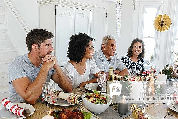 Family talking and bonding at home party