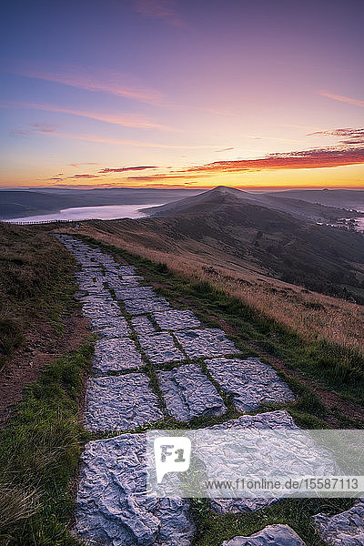 Limestone path leading to Lose Hill and Back Tor from Mam Tor with amazing sunrise  The Peak District National Park  Derbyshire  England  United Kingdom