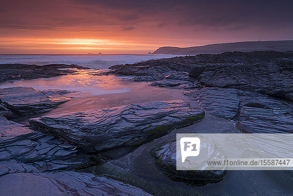 Incredible sunset over the rocky shores of Boobys Bay near Trevose Head in Cornwall  England  United Kingdom