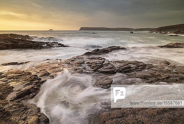 Waves surge over rock ledges on the North Cornish coast  Cornwall  England  United Kingdom