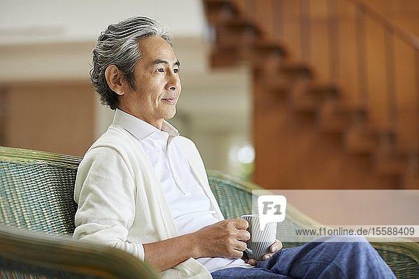 Senior Japanese man at home