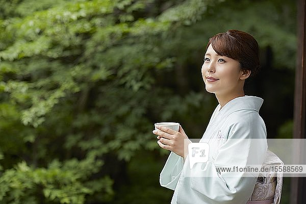 Young Japanese woman wearing traditional kimono
