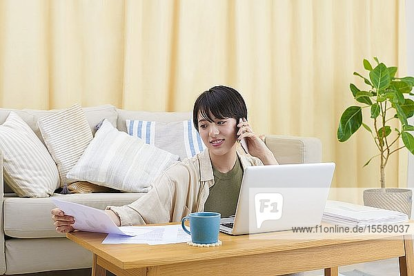 Young Japanese woman working at home