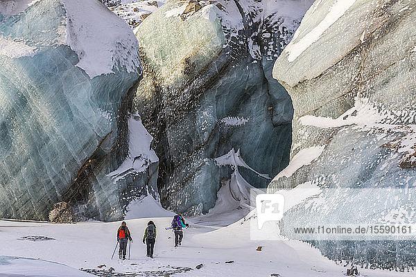 Winter hikers exploring Black Rapids Glacier; Alaska  United States of America