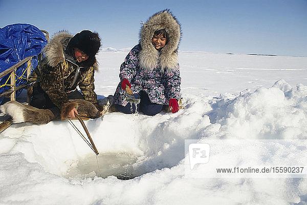 Natives Ice Fishing In Kotzebue Western Alaska Winter