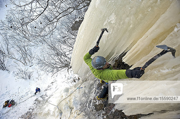 Ice Climber Ascends A Large Icefall (Route Tj Swan) In Eklutna Canyon  Southcentral Alaska