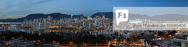 Panorama of lights illuminating the city of Vancouver at night; Vancouver  British Columbia  Canada