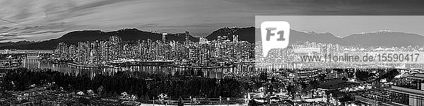 Black and white panorama of lights illuminating the city of Vancouver at night; Vancouver  British Columbia  Canada