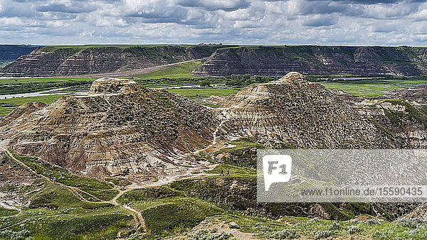 Tourists on a trail in Horse Thief Canyon  Starland County; Alberta  Canada