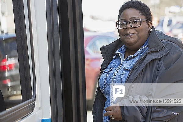 Portrait of a woman with bipolar disorder standing near a bus
