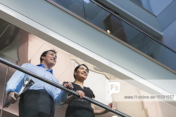 Business couple in atrium of office building