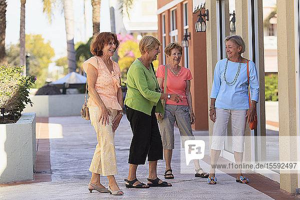 Senior friends doing outdoor shopping