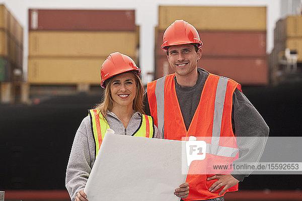 Transportation engineers holding a blueprint