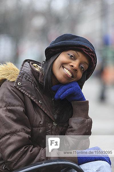 Portrait of a woman smiling  Boston  Suffolk County  Massachusetts  USA Portrait of a woman smiling, Boston, Suffolk County, Massachusetts, USA