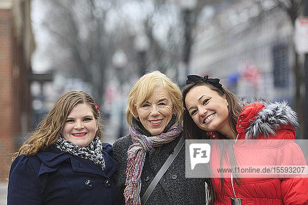 Portrait of three women smiling  Boston  Suffolk County  Massachusetts  USA