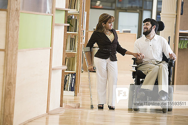 Man with Cerebral Palsy and woman smiling.
