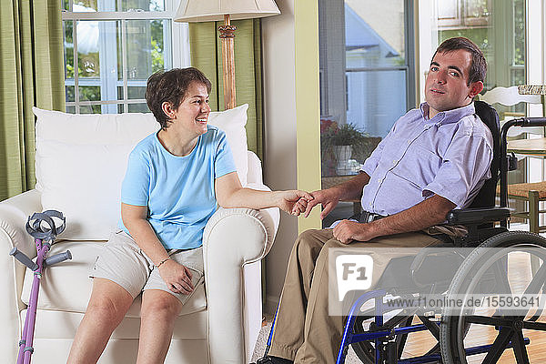 Couple with Cerebral Palsy holding hands