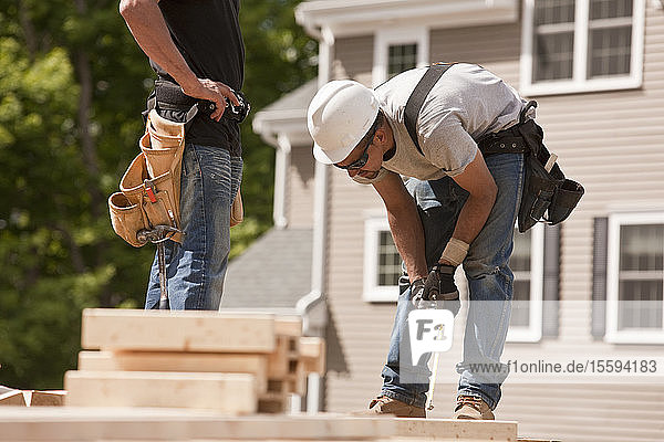 Carpenters marking studs