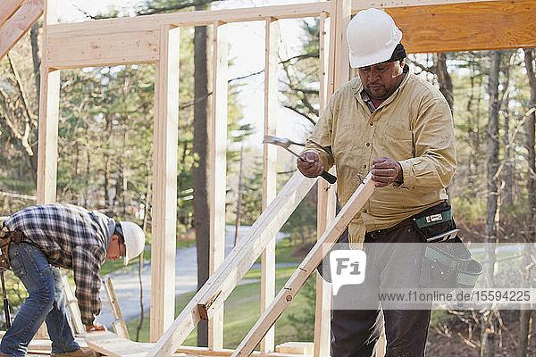 Carpenter preparing stud
