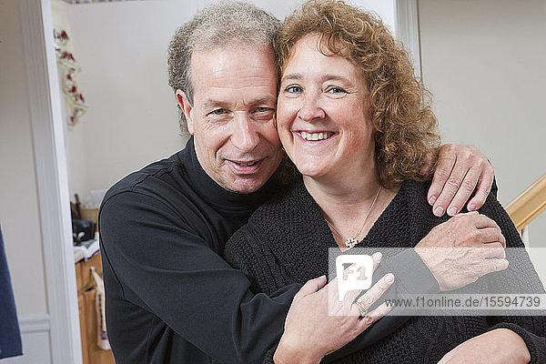 Portrait of a mature romantic couple smiling