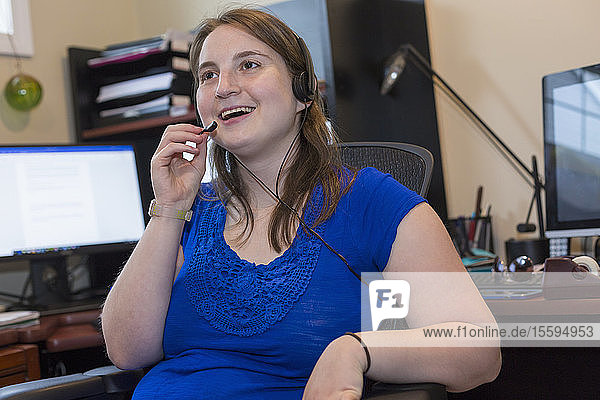 Young Woman with Cerebral Palsy wearing headset