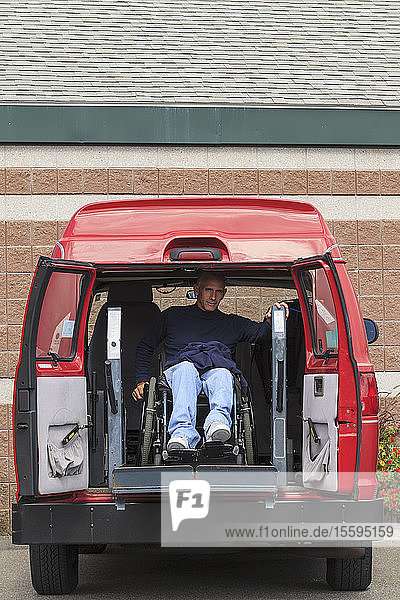 Man with spinal cord injury exiting his accessible van