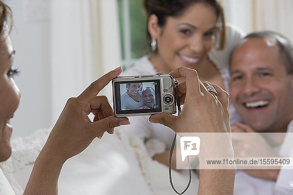 Hispanic woman taking a picture of her friends