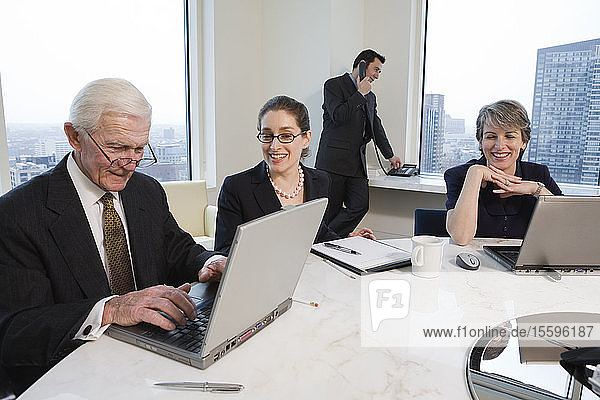 View of businesspeople working in an office.