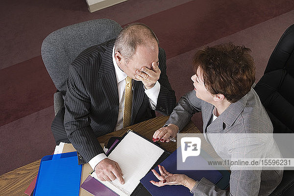 View from above of a frustrated business man and business woman.