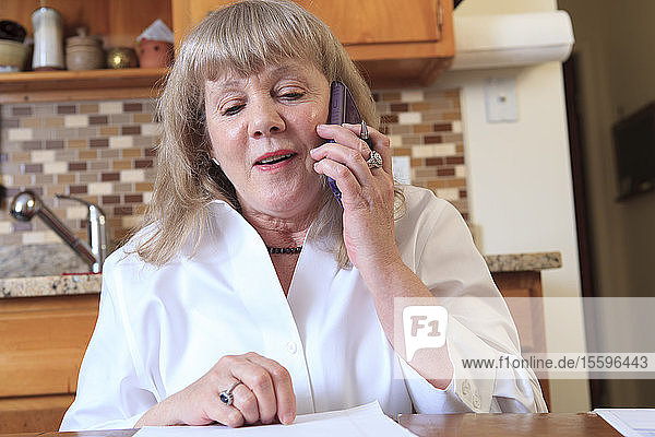 Woman with Bipolar disorder working from home on her phone
