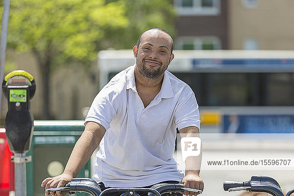 Man with Down Syndrome riding a bike