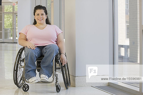Woman with Spina Bifida sitting in a wheelchair and smiling
