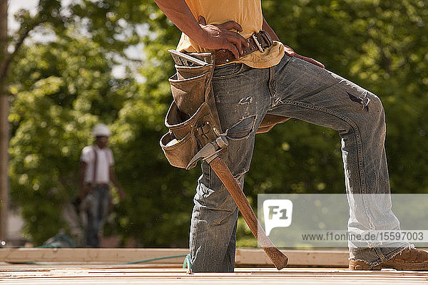 Carpenter standing at a construction site
