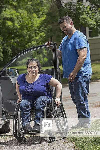 Woman with Spina Bifida and her husband getting out of the car