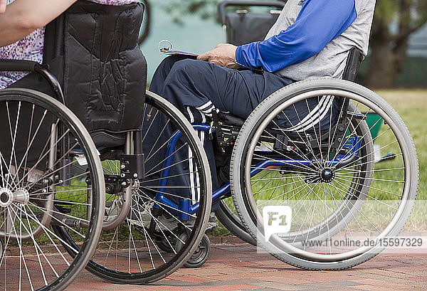 Man with multiple Sclerosis and a woman with spinal cord injury in wheelchairs