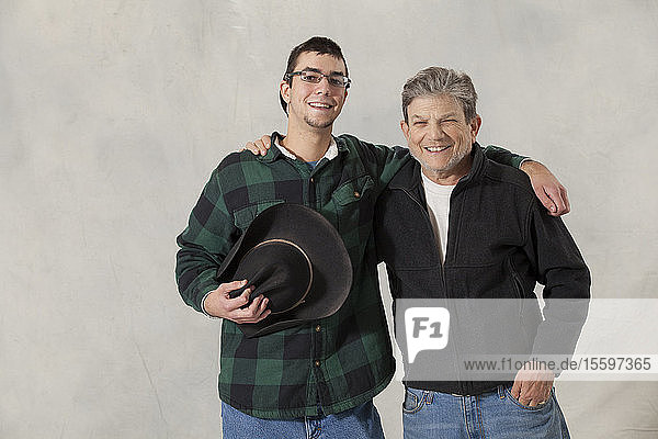 Portrait of a young man with autism and his mentor smiling