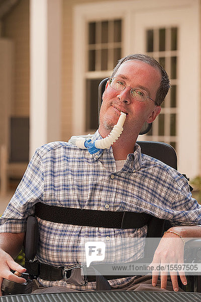 Man with Duchenne muscular dystrophy with a breathing ventilator