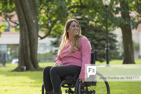 Woman with Spinal Cord Injury sitting in wheelchair in a park