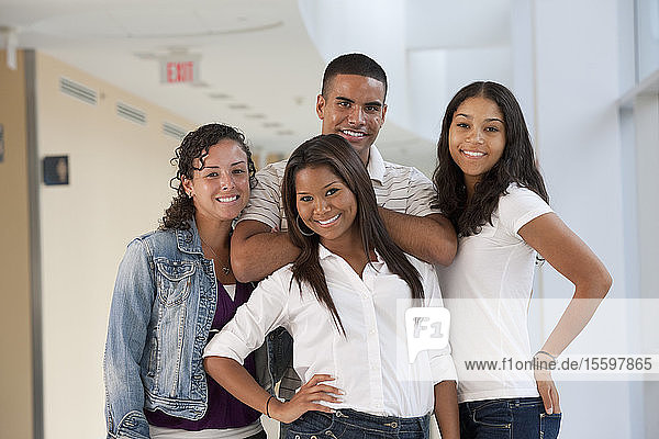 Portrait of four university students smiling