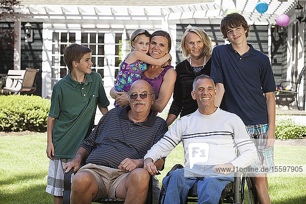 Portrait of an extended family with a man with spinal cord injury in wheelchair