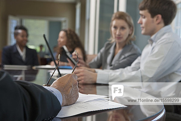 Business executives in a board meeting  one with Spinal Cord Injury