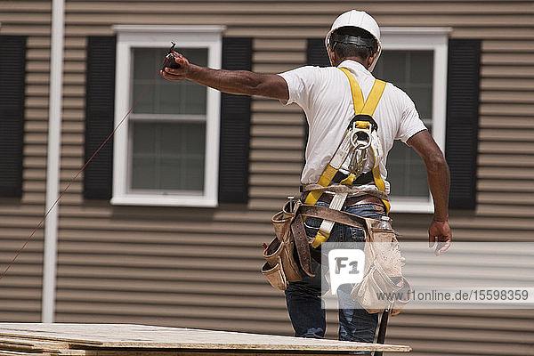 Carpenter pulling a chalk string line